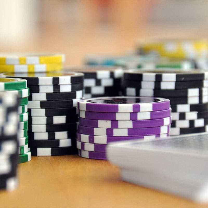 black, green. and purple poker chips