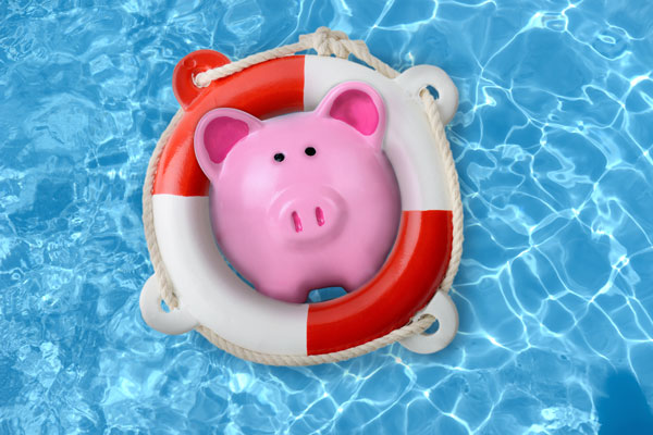 A piggy bank in a pool with a lifesaver
