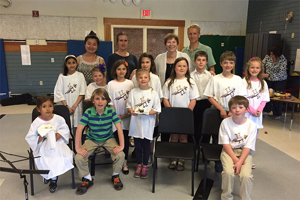 A group of kids in a music room - Camerata