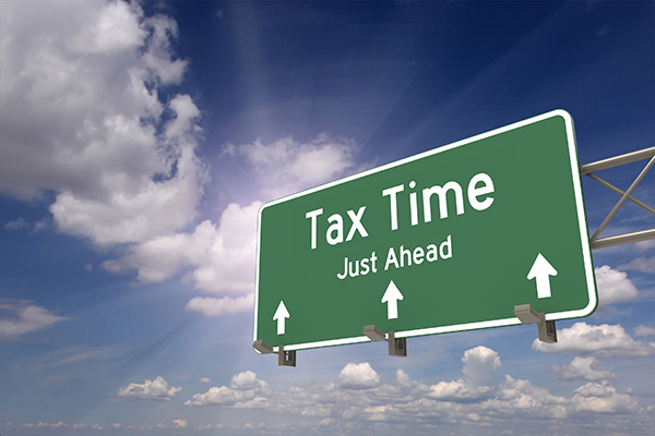 billboard against blue sky with Tax Time Just Ahead