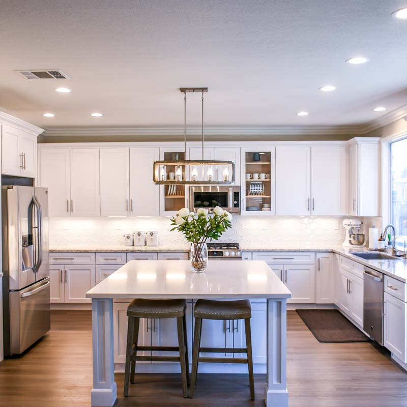 Interior shot of newly renovated kitchen with marble counters and stainless steel appliances
