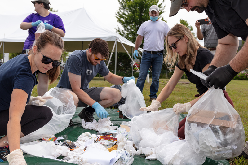 group of people sorting garbage for recycling